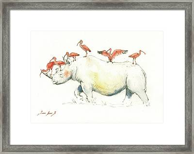 Rhino And Ibis Framed Print by Juan Bosco