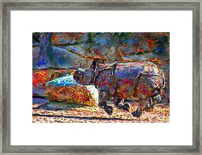 Rhino On The Run Framed Print by Marilyn Sholin