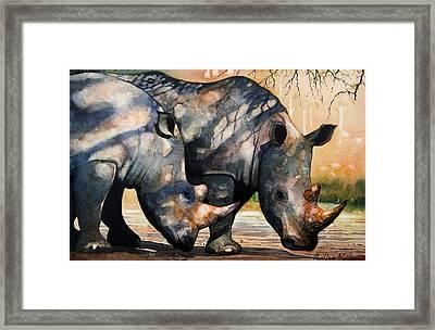 Rhinos In Dappled Shade. Framed Print