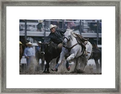 Ricky Huddleston Drops Off His Horse Framed Print
