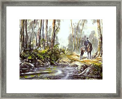 Rider By The Creek Framed Print
