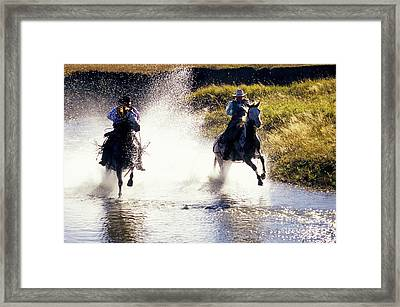 Riders In A Creek Framed Print by Inga Spence