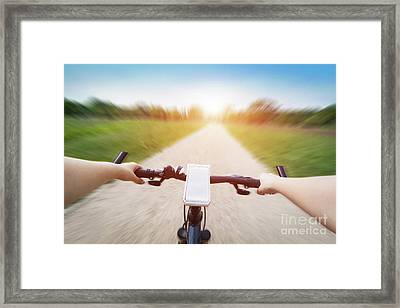 Riding A Bike First Person Perspective. Smartphone On Handlebar. Speed Motion Blur Framed Print