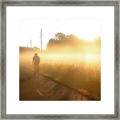 Riding Into The Morning Fog Framed Print