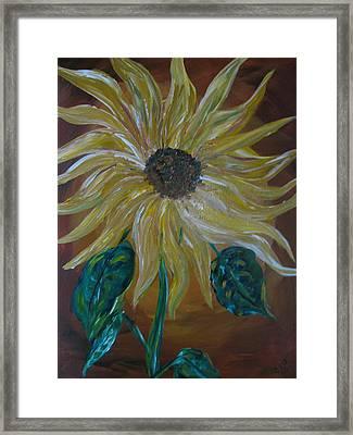 Rising Sunflower Framed Print by Dennis Poyant