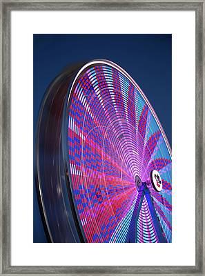 River Bandit's Spinning Ferris Wheel Framed Print by Tom Weisbrook