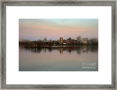 Riverfront At Dusk Framed Print by Debra Straub