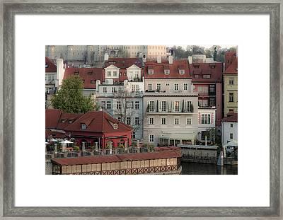 Riverside Below Prague Castle Framed Print by Marek Boguszak