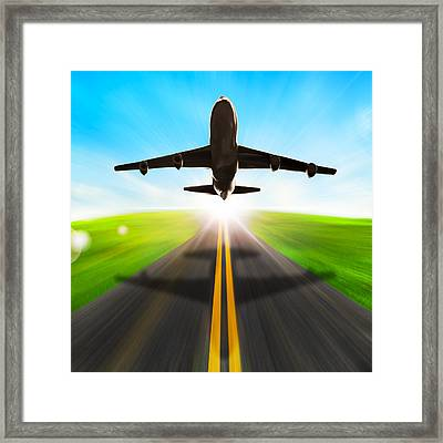 Road And Plane Framed Print by Setsiri Silapasuwanchai