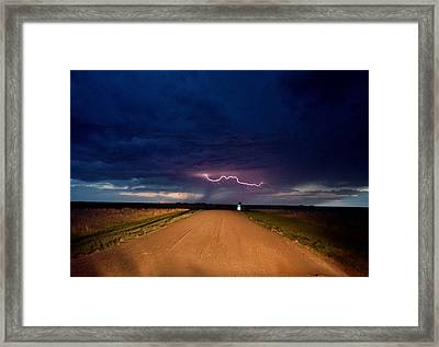 Framed Print featuring the photograph Road Under The Storm by Ed Sweeney