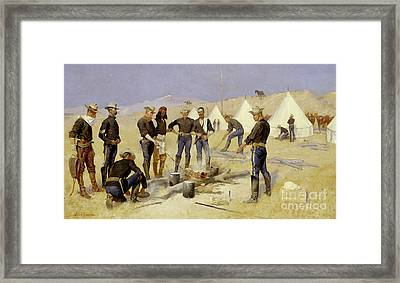 Roasting The Christmas Beef In A Cavalry Camp, 1892 Framed Print by Frederic Remington