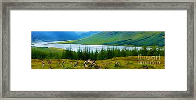 Rock Cairns In Scotland Framed Print