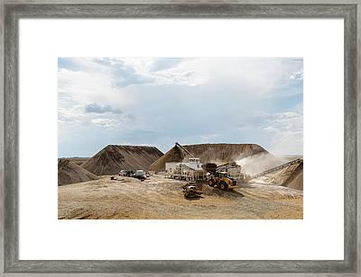 Rock Crushing Framed Print
