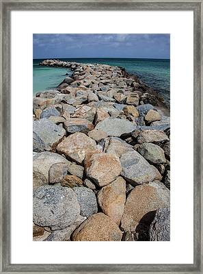 Rock Jetty Of The Caribbean Framed Print by David Letts