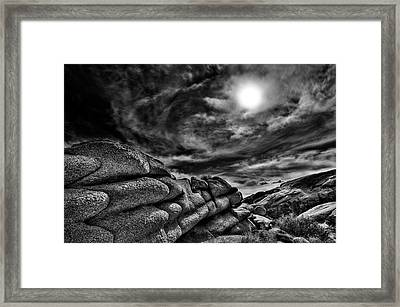 Rock Ledge With Swirling Sky Framed Print by Gary Zuercher