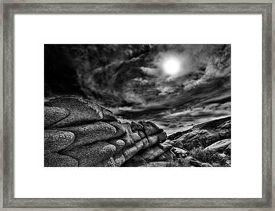 Rock Ledge With Swirling Sky Framed Print by Gary Zuercher