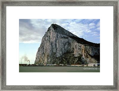 Rock Of Gibrlatar Stands Over The Gibraltar International Airpor Framed Print by Wernher Krutein