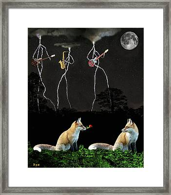 Rocking Foxs Framed Print by Eric Kempson