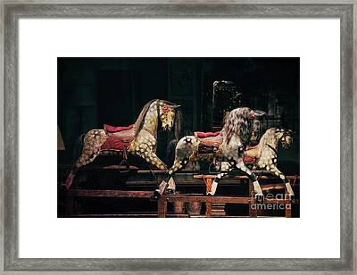 Rocking Horses Framed Print by Tim Gainey