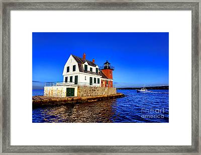 Rockland Harbor Light And Fishing Boat Framed Print