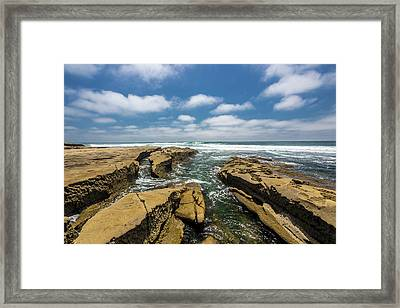 Rocks And Puffies Framed Print