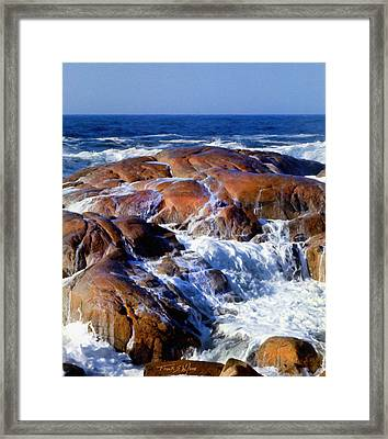 Rocks Awash Framed Print