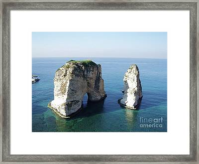Rocks In Sea Framed Print