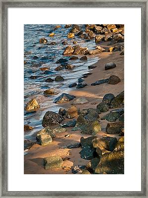 Harmony In Nature - Rocks, Pebbles, And Waves On Sandy Beach Framed Print by Aaron Sheinbein