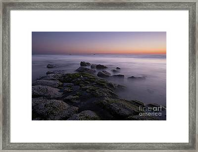 Rocks On The Beach At Sunset Framed Print