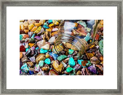 Rocks Pouring Out Of Glass Jar Framed Print