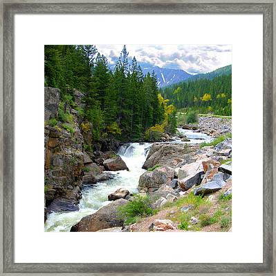 Rocky Mountain Stream Framed Print by John Lautermilch