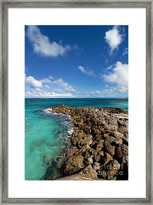 Rocky Shoreline On The Beach At Atlantis Resort Framed Print