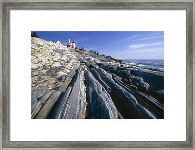 Rocky Shoreline With A Lighthouse Pemaquid Point Maine Framed Print by George Oze