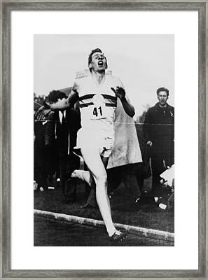 Roger Bannister Crossing The Finish Framed Print