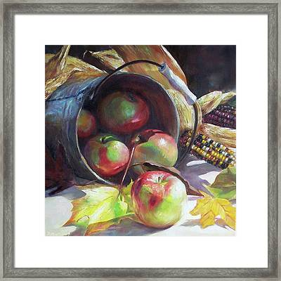 Rolling Apples Framed Print by Donna Munsch
