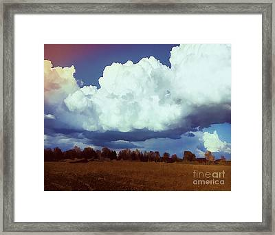 Rolling Spring Clouds Framed Print by Luther Fine Art