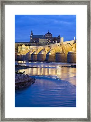 Roman Bridge On Guadalquivir River At Dawn Framed Print
