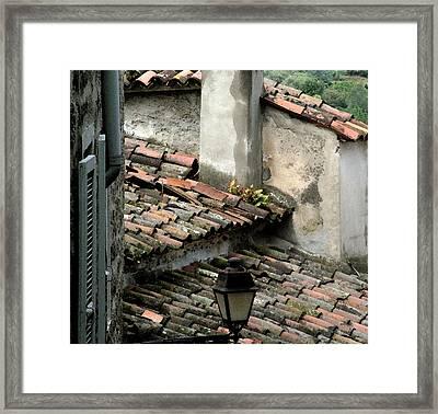 Rooftops Corsica Framed Print by John Bradburn