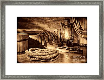 Rope And Tools In A Barn Framed Print