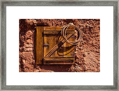 Rope Hanging On Small Door Framed Print
