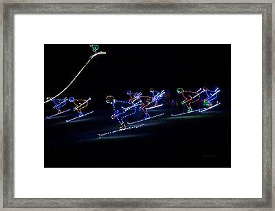 Rope Light Art Skiers Framed Print by Thomas Woolworth