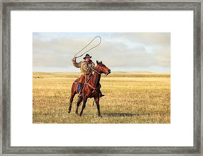 Roping On The High Plains Framed Print by Todd Klassy