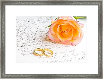 Rose And Two Rings Over Handwritten Letter Framed Print