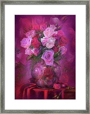 Roses In Rose Vase Framed Print by Carol Cavalaris