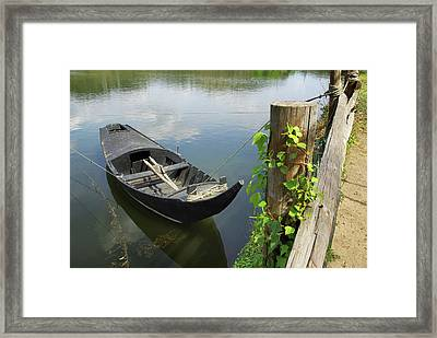 Row Boat On The Shoreline Framed Print by Carlos Caetano