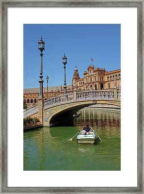 Row Boating In Seville Framed Print by Carlos Caetano