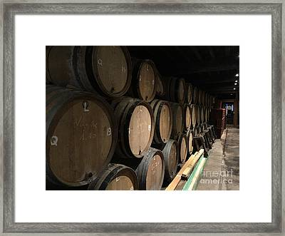 Row Of Barrels Framed Print by Evan N