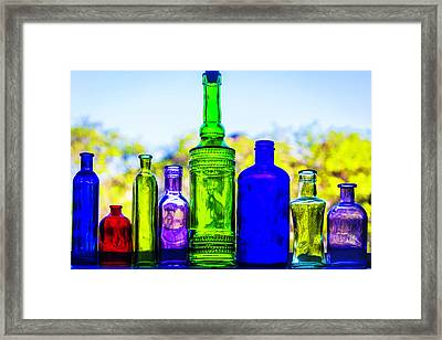Row Of Colored Bottles Framed Print