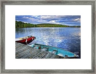 Rowboats On Lake At Dusk Framed Print by Elena Elisseeva