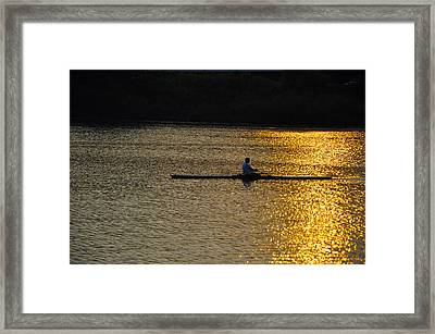 Rowing At Sunset Framed Print